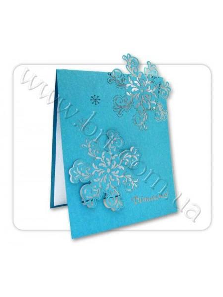 Новорічна листівка зі сніжинками